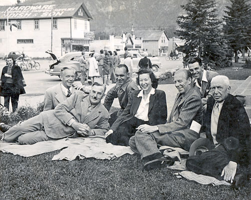 Painting Faculty in 1948. 1948, Banff School of Fine Arts.<br />(Taken in front of Banff Auditorium on Banff Ave.).<br />Left to Right: J.W.G. Macdonald, Walter J. Phillips, Murray MacDonald, Holly Middleton, H.G. Glyde, J.B. Taylor, James Dichmont.