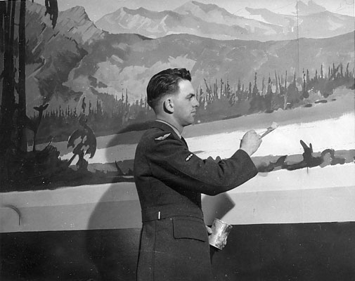 LAC J. B. Taylor with unknown man in front of mural of Peace River District, in Officer's Lounge, North West Air Command, Edmonton. c.1945.